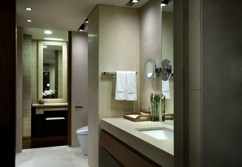 bathroom mirror property sink home lighting plumbing fixture