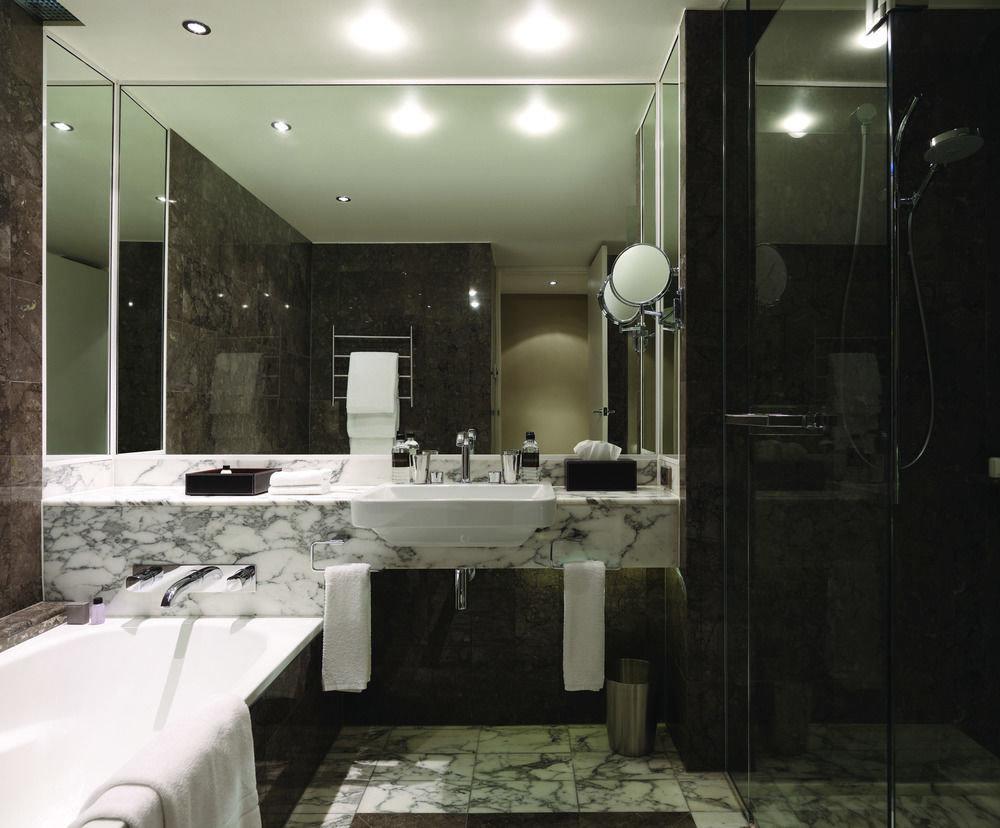 bathroom property sink toilet lighting home