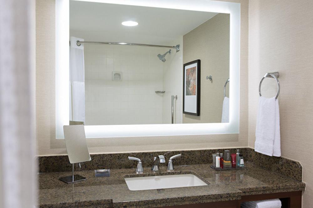 bathroom mirror sink property home plumbing fixture towel living room