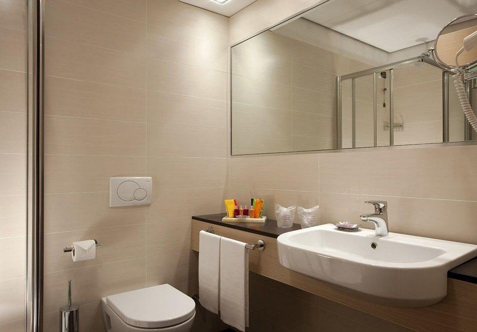 bathroom sink mirror property toilet home plumbing fixture rack
