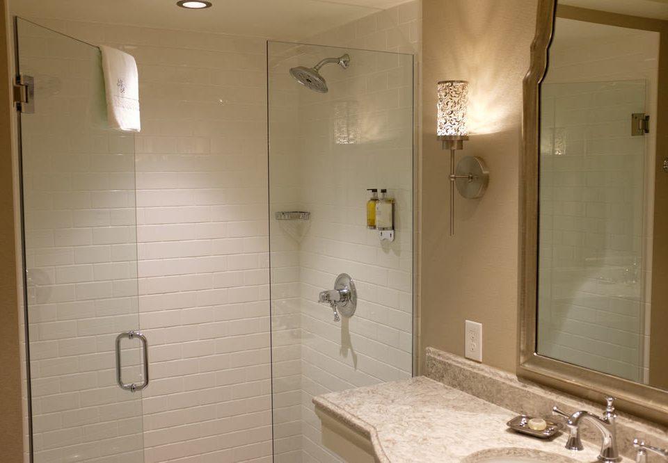 bathroom mirror sink property plumbing fixture towel home