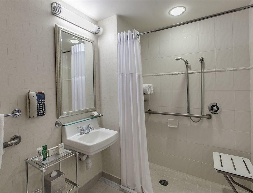 bathroom sink property mirror toilet home plumbing fixture public toilet rack