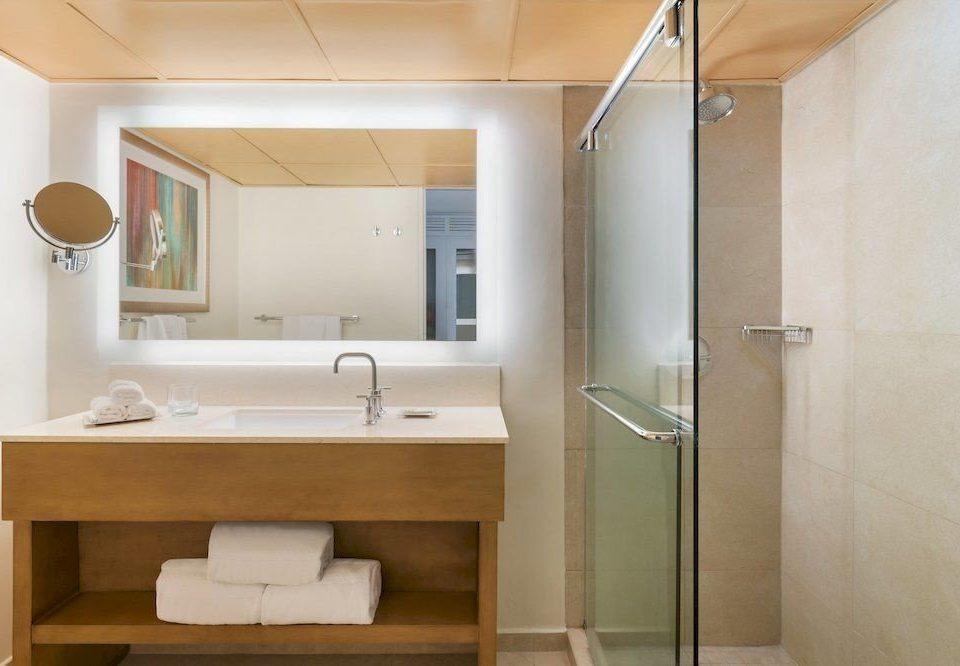 bathroom mirror property sink plumbing fixture shower home toilet tan