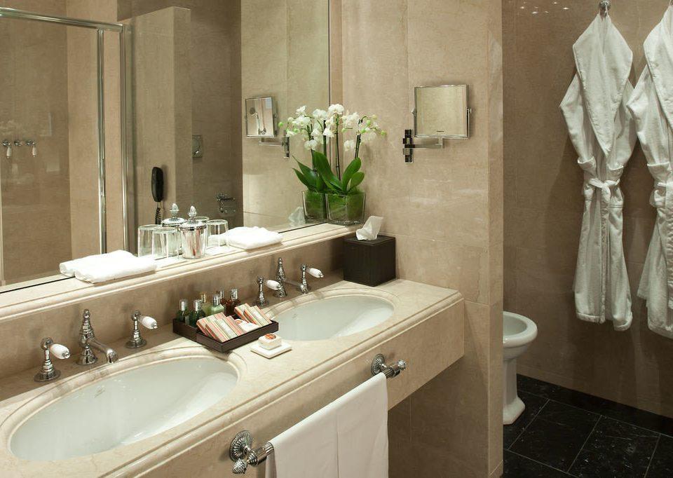 bathroom sink mirror property home toilet towel plumbing fixture tan
