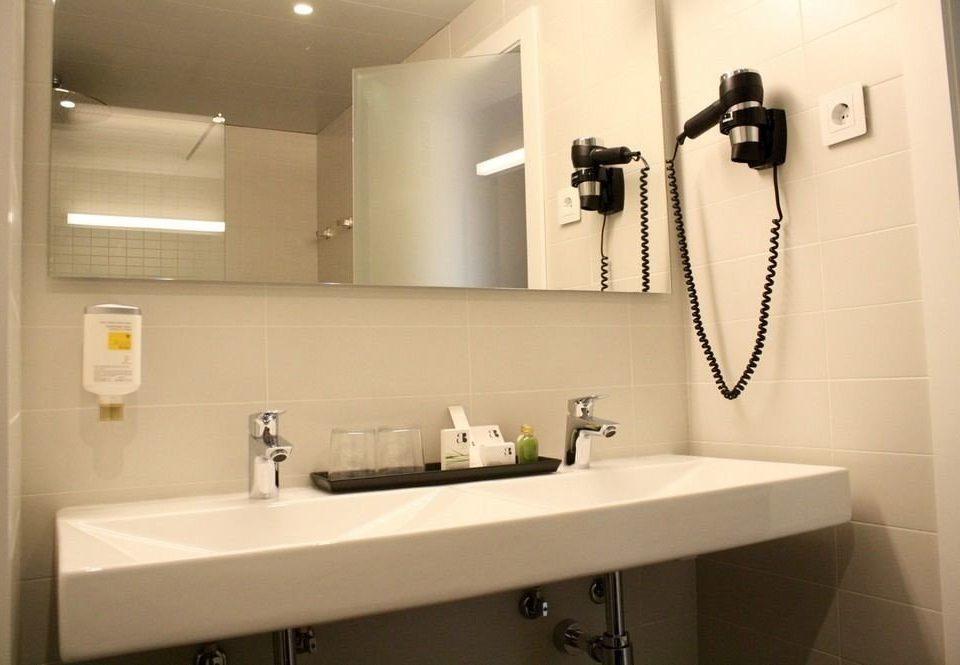 bathroom mirror sink property toilet home plumbing fixture