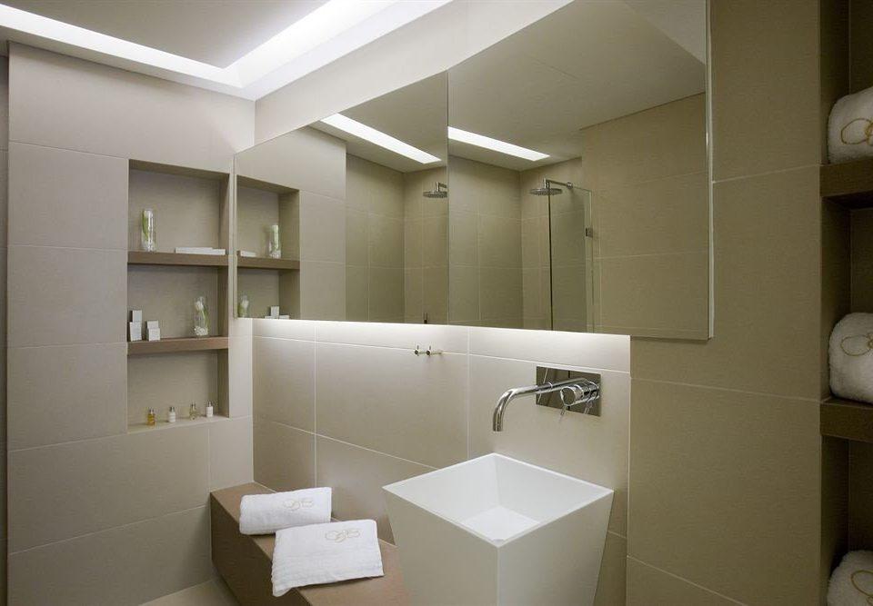 bathroom mirror property sink home toilet plumbing fixture