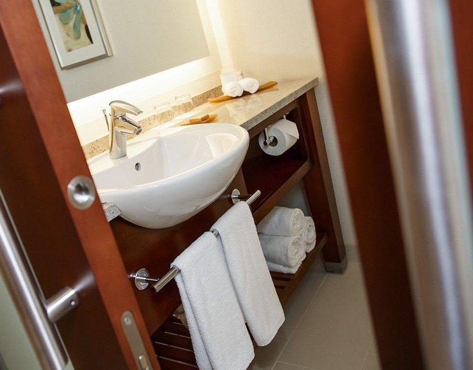 bathroom sink property toilet home plumbing fixture towel rack