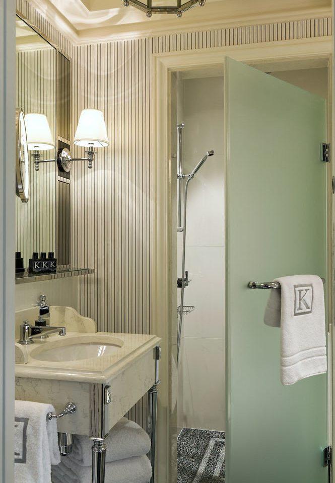 bathroom property sink home plumbing fixture white public toilet toilet rack