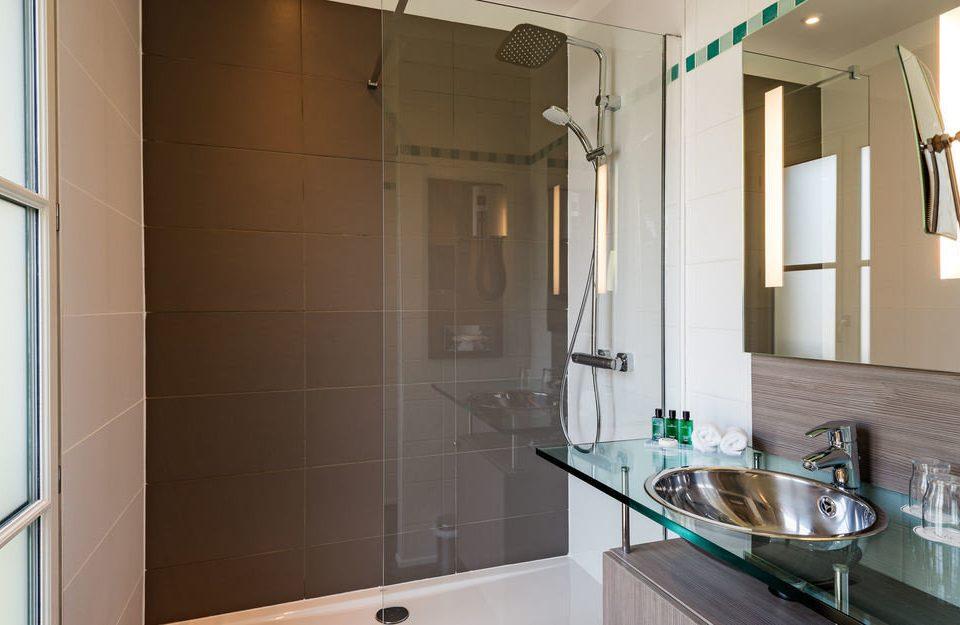 bathroom property home sink plumbing fixture tiled tile