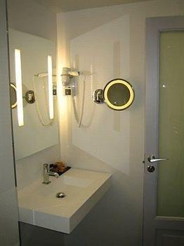 bathroom sink mirror property plumbing fixture light