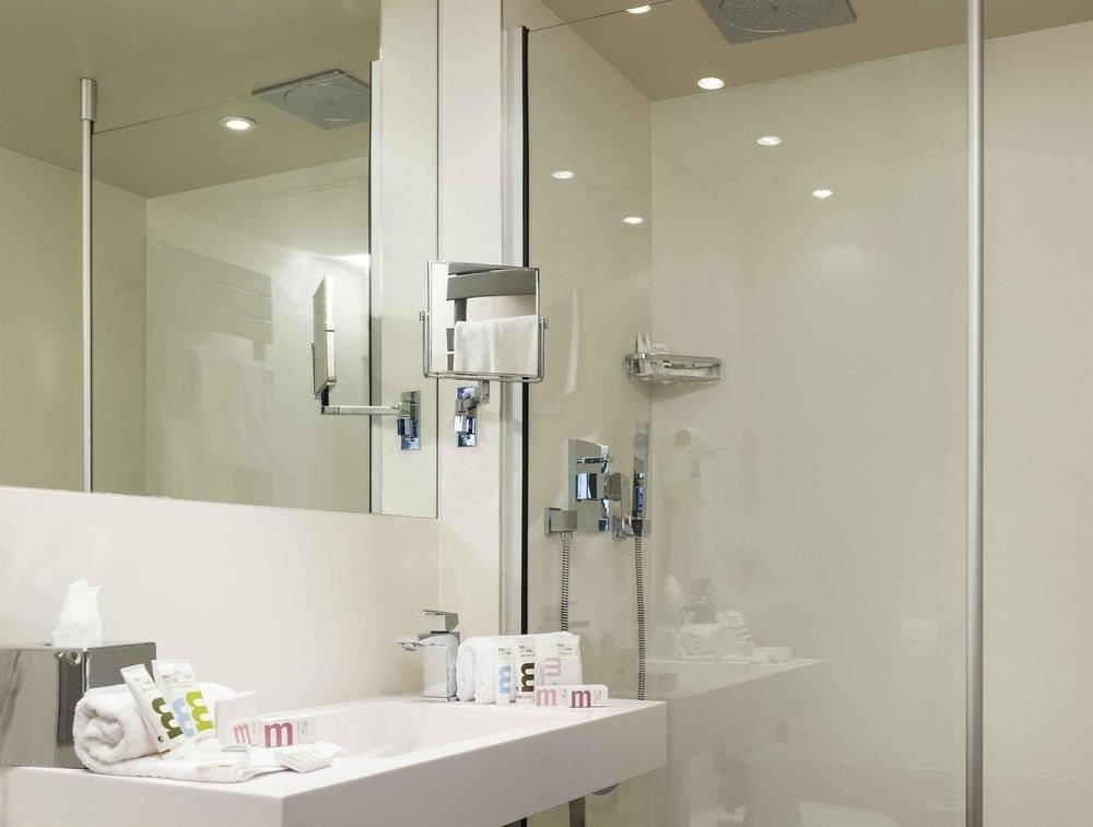 bathroom mirror sink property white lighting shower plumbing fixture