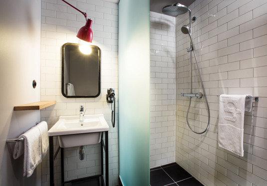bathroom property toilet lighting plumbing fixture tiled tile