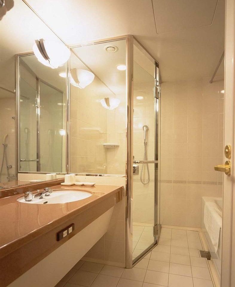 bathroom property lighting plumbing fixture toilet stall tan