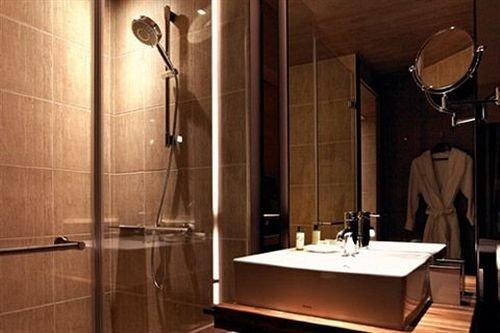 bathroom plumbing fixture lighting sink toilet tiled