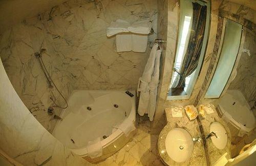 bathroom man made object plumbing fixture toilet