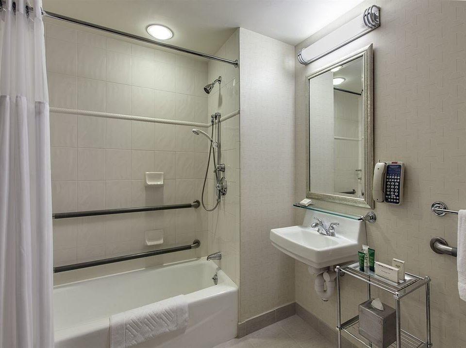 bathroom property mirror toilet sink white plumbing fixture