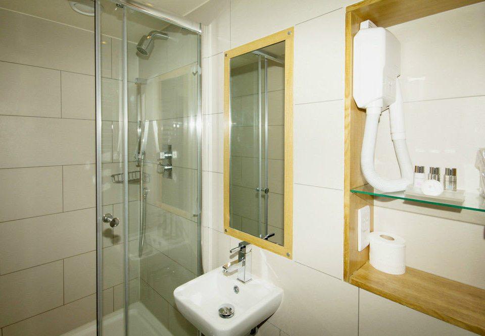 bathroom mirror toilet property sink plumbing fixture