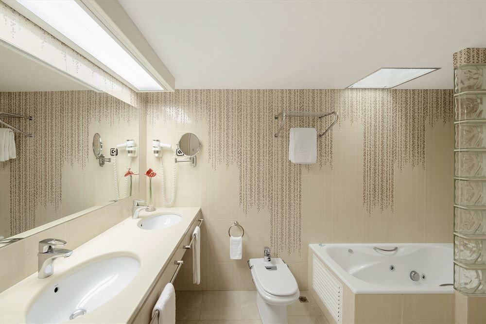 bathroom sink mirror toilet property white plumbing fixture tile