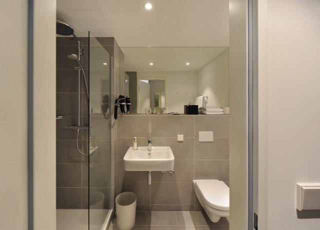 bathroom toilet mirror property sink plumbing fixture