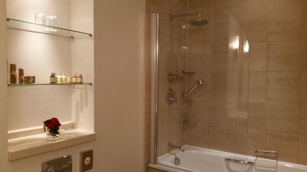 bathroom mirror property sink toilet plumbing fixture tile tiled
