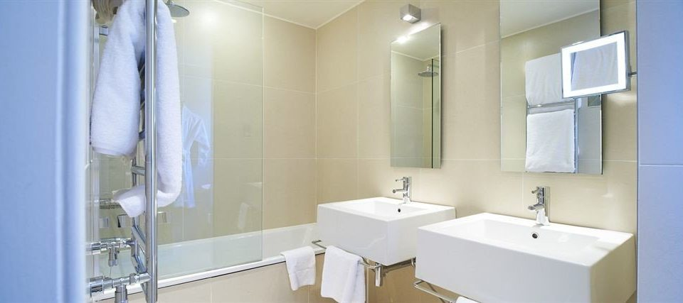 bathroom mirror sink property white plumbing fixture toilet