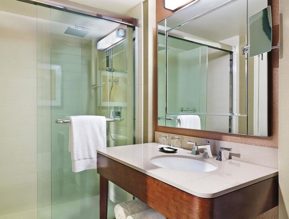 bathroom mirror sink property shower plumbing fixture tan