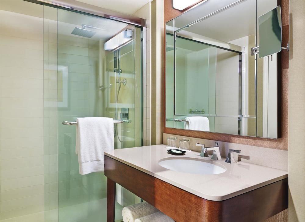 bathroom mirror sink property shower plumbing fixture tan