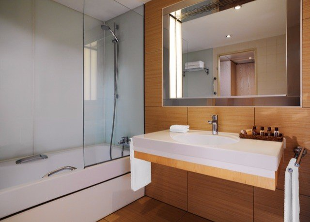 bathroom mirror sink property plumbing fixture