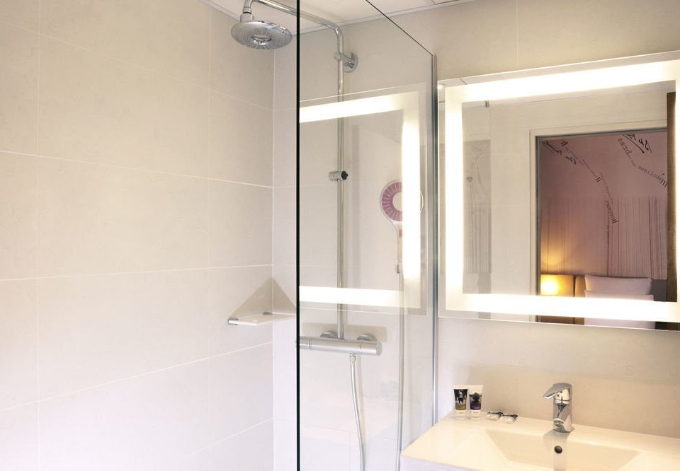 bathroom mirror property sink plumbing fixture toilet