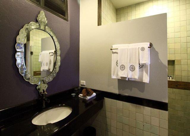 bathroom mirror sink toilet plumbing fixture public tiled