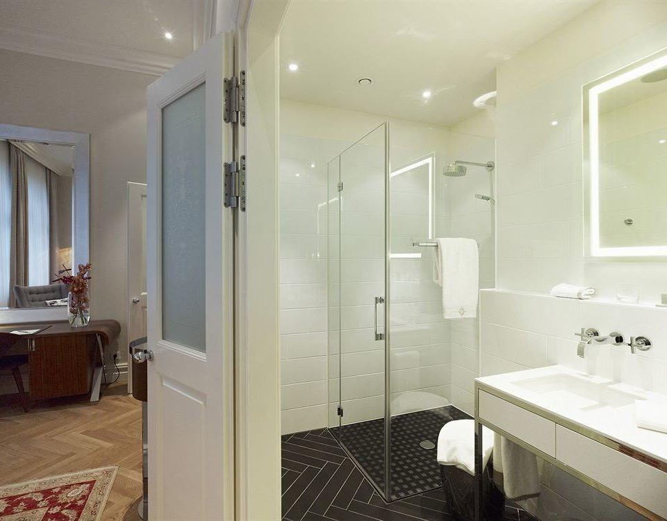 bathroom mirror property sink white shower tile tub tiled