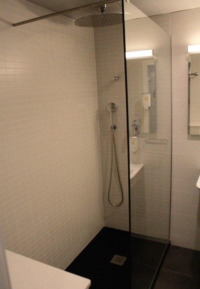 bathroom property toilet plumbing fixture public toilet tile tiled
