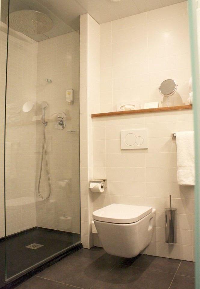 bathroom property sink toilet plumbing fixture white public toilet tan