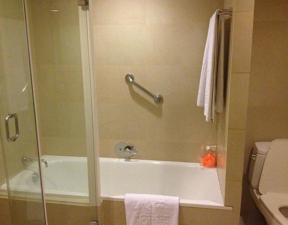 bathroom property shower plumbing fixture toilet sink towel rack