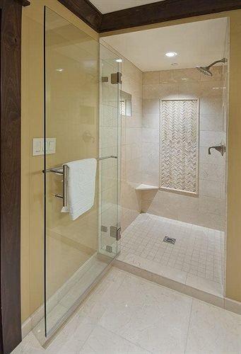 bathroom property plumbing fixture sink shower toilet tile tiled tan