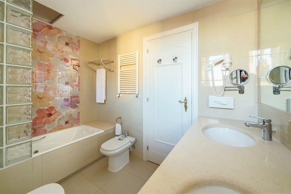 bathroom sink toilet property plumbing fixture