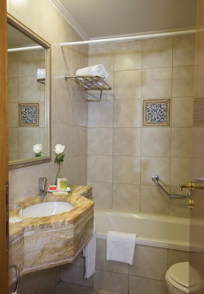 bathroom property sink toilet plumbing fixture tan