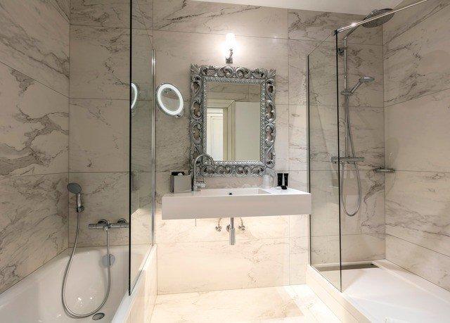 bathroom property sink white toilet plumbing fixture tile tiled