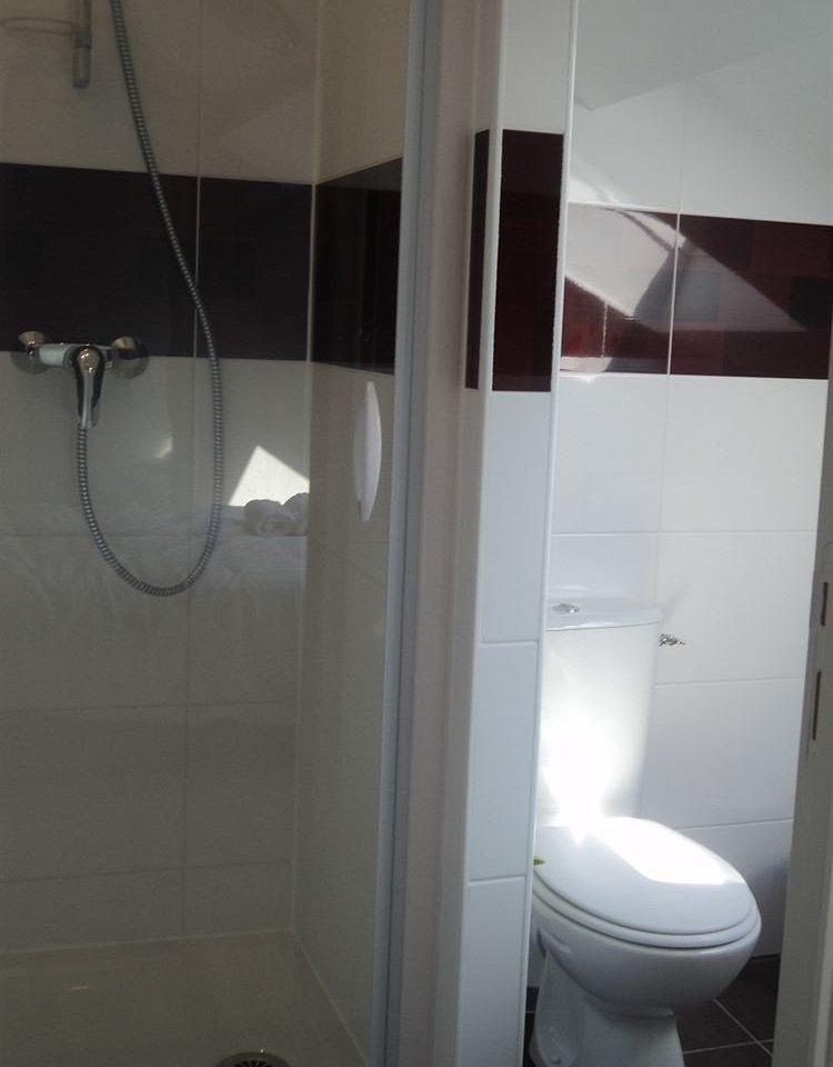 bathroom toilet property plumbing fixture tiled tile