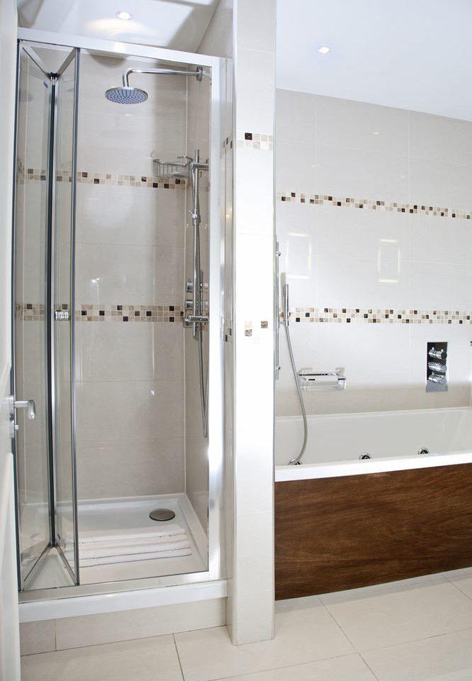 white plumbing fixture scene bathroom shower toilet public toilet