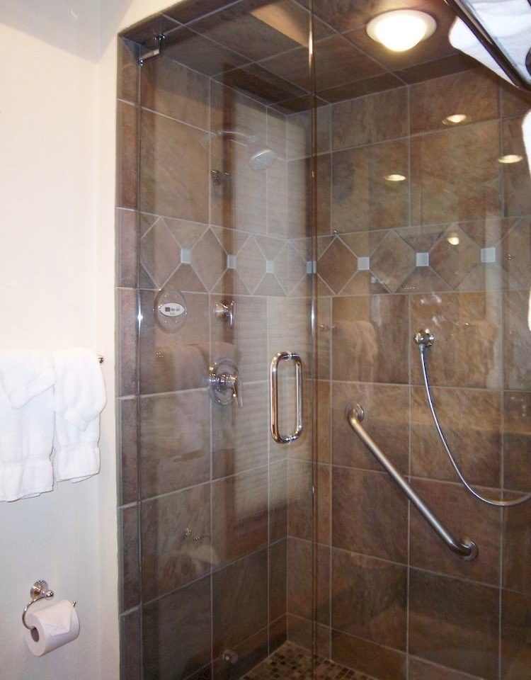bathroom scene plumbing fixture shower public toilet tiled