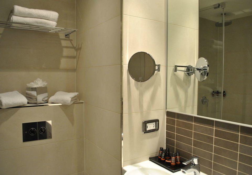 bathroom toilet plumbing fixture public toilet sink tile tiled