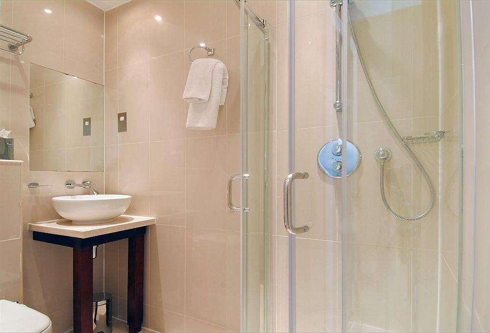 bathroom scene shower sink plumbing fixture towel rack
