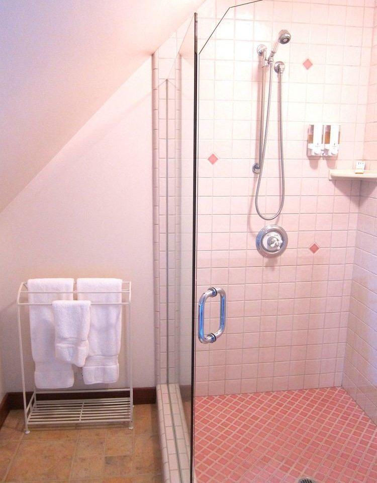 bathroom plumbing fixture scene shower tiled tile