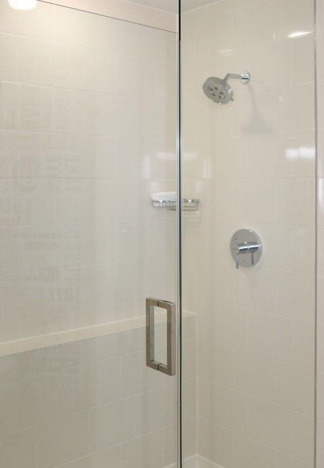 bathroom scene plumbing fixture shower white stall tiled tile
