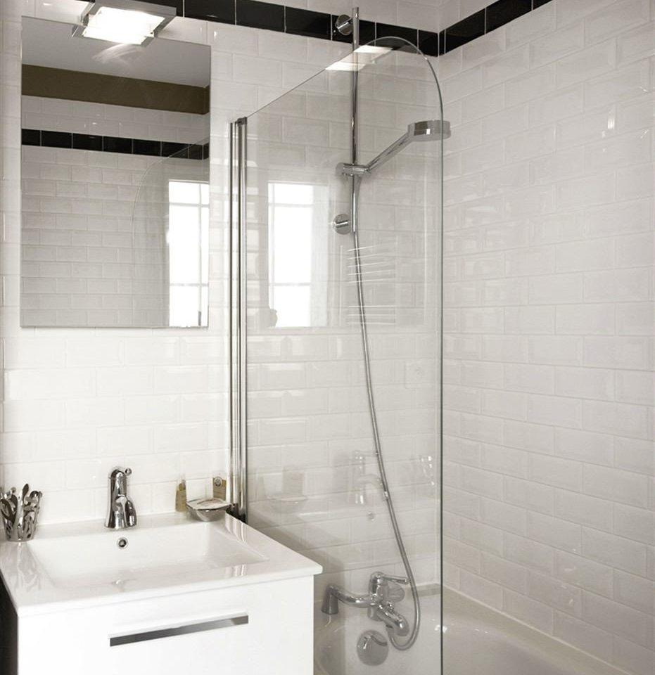 bathroom white plumbing fixture sink toilet tile tiled