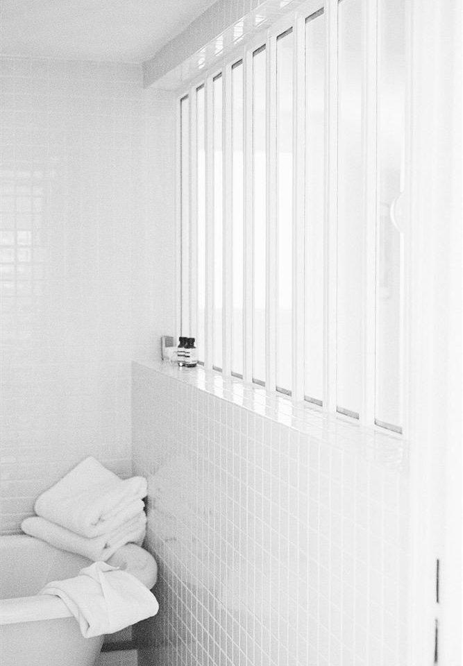 bathroom white toilet plumbing fixture