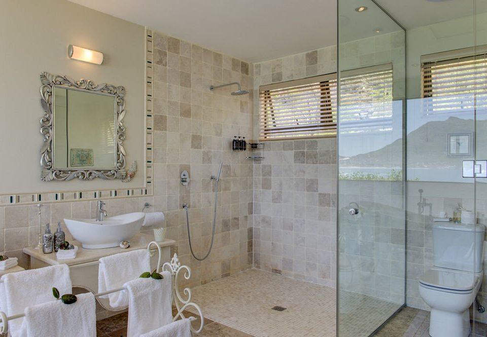 bathroom property toilet public toilet tiled tan