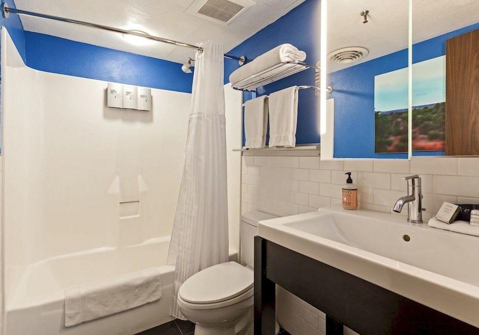 bathroom sink property white toilet tile