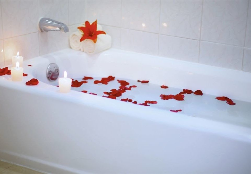 white red bathtub vessel plumbing fixture flooring ceramic flower